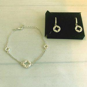 Avon silver toned bracelet and drop earrings. NIB